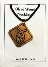 Load image into Gallery viewer, Handmade in Bethlehem, olive wood cross in fish, square pendant with black cord in packaging