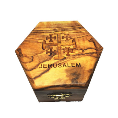 Polished olive wood trinket box hand made in Bethlem. Golden clasp on from and Jerusalem cross and wording on top