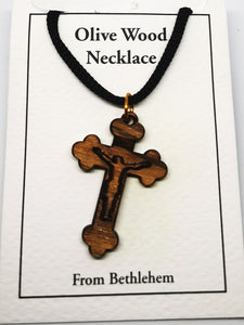Handmade in Bethlehem, olive wood crucifix pendant with black cord in packaging