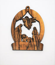Load image into Gallery viewer, 2D olive wood Christmas decoration. Angel visiting Mary, Joseph and baby Jesus. Made in Bethlehem