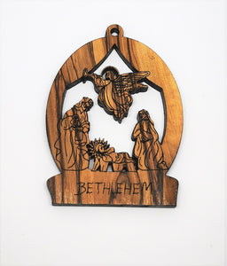 2D olive wood Christmas decoration. Angel visiting Mary, Joseph and baby Jesus. Made in Bethlehem