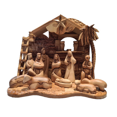 faceless figures in large stable handmade in Bethlehem from olive wood