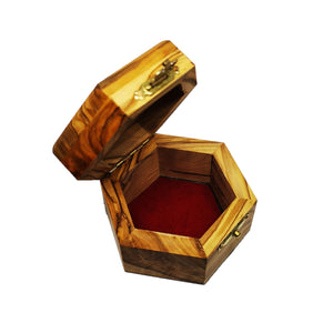 Inside of olive wood trinket box hand made in Bethlehem , lined with red velvet