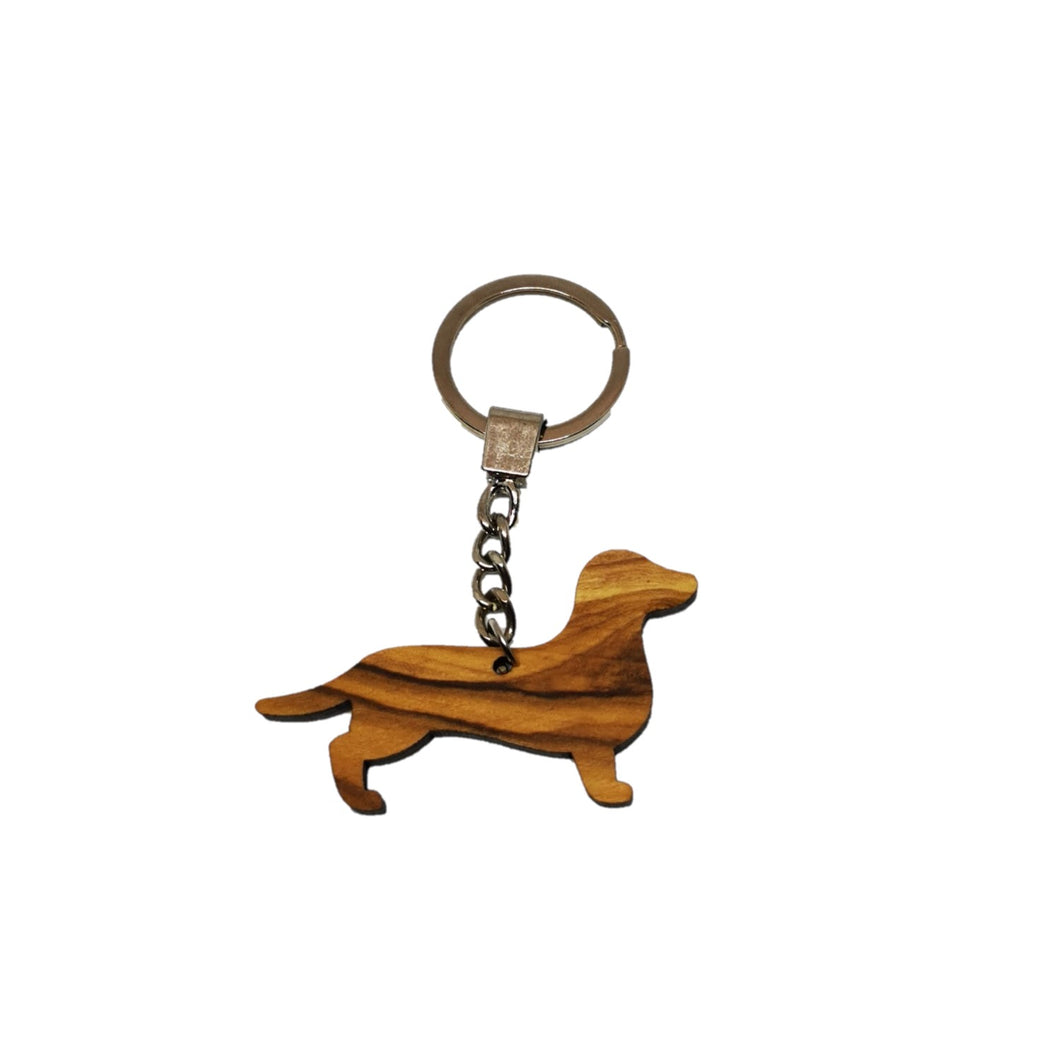 Plain sausage dog olive wood decoration made in Bethlehem. Keyring on chain