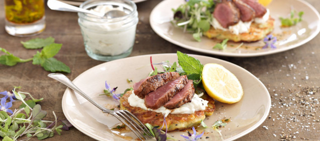 Lamb Medallions Served on Corn and Feta Fritters Topped with Fennel Tzatziki