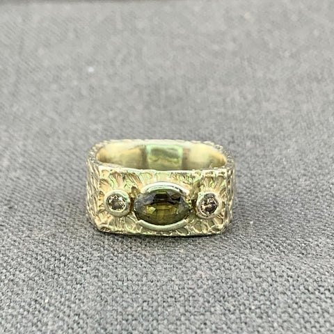 1.98 carat brown/green sapphire ring with diamond accents in 14kt green gold