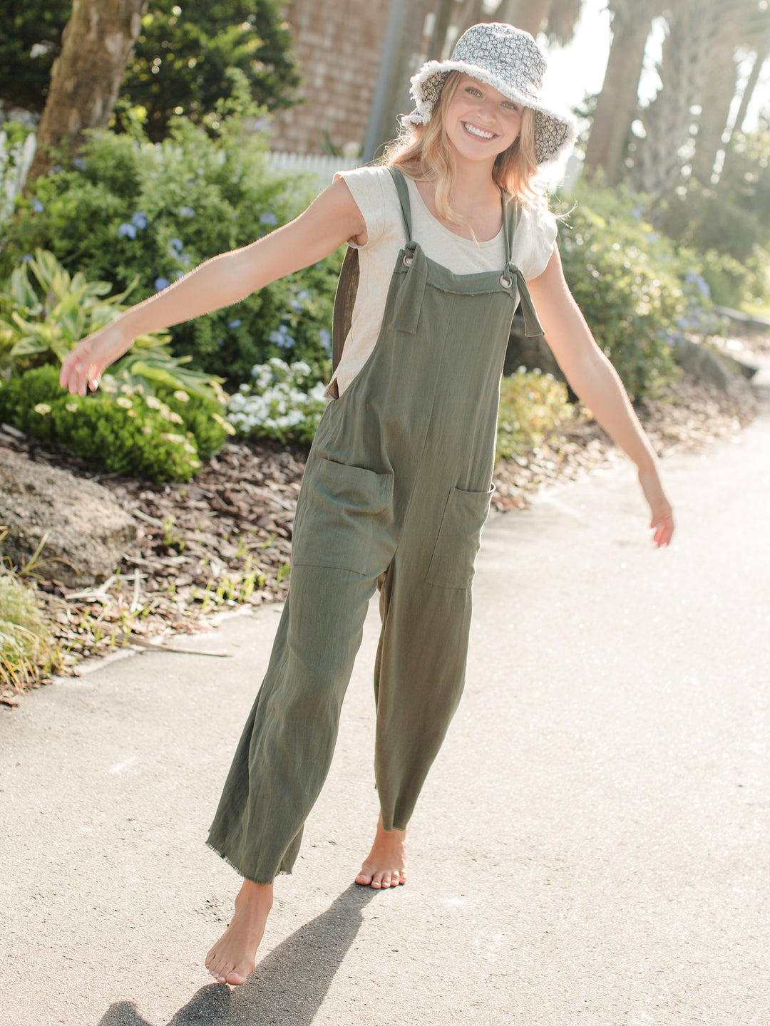 https://cdn.shopify.com/s/files/1/0409/9656/9251/products/Carly_Jumpsuit_Olive-A7_1080x.jpg