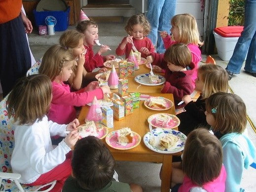 kids at table with birthday cake