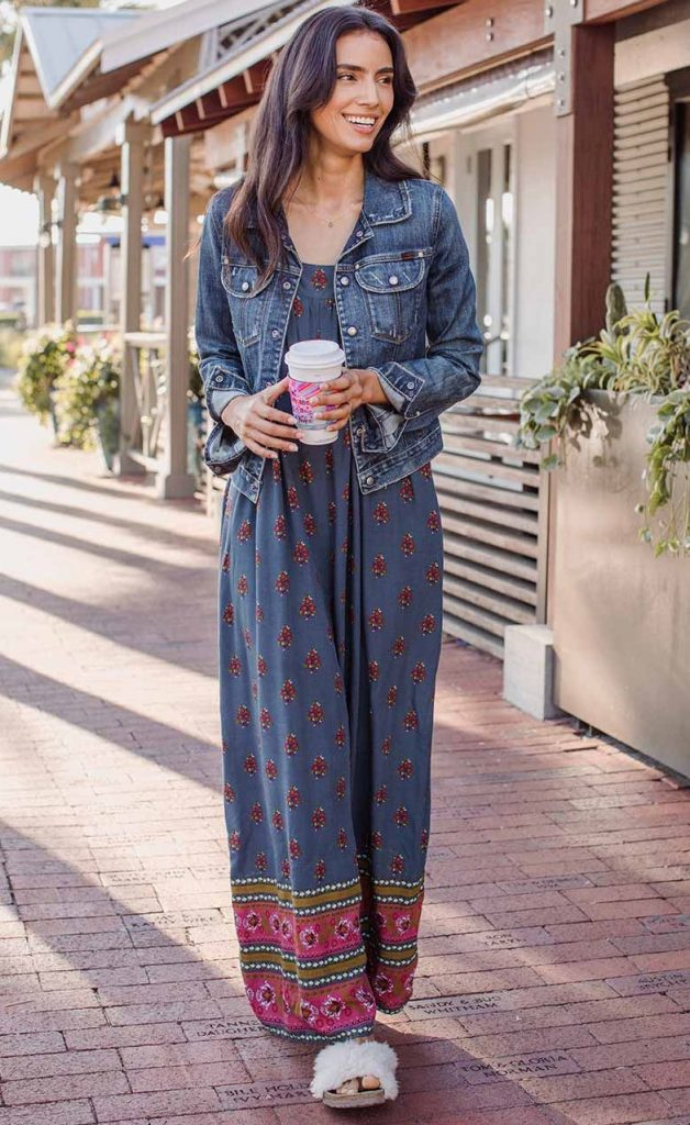 Girl walking with coffee wearing colorful jumpsuit
