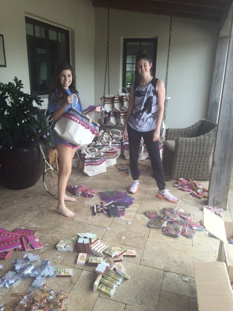 Girls putting together tote bags of treasures