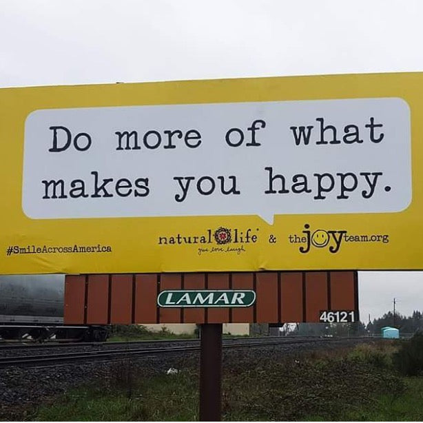 "Billboard that says ""Do more of what makes you happy."""