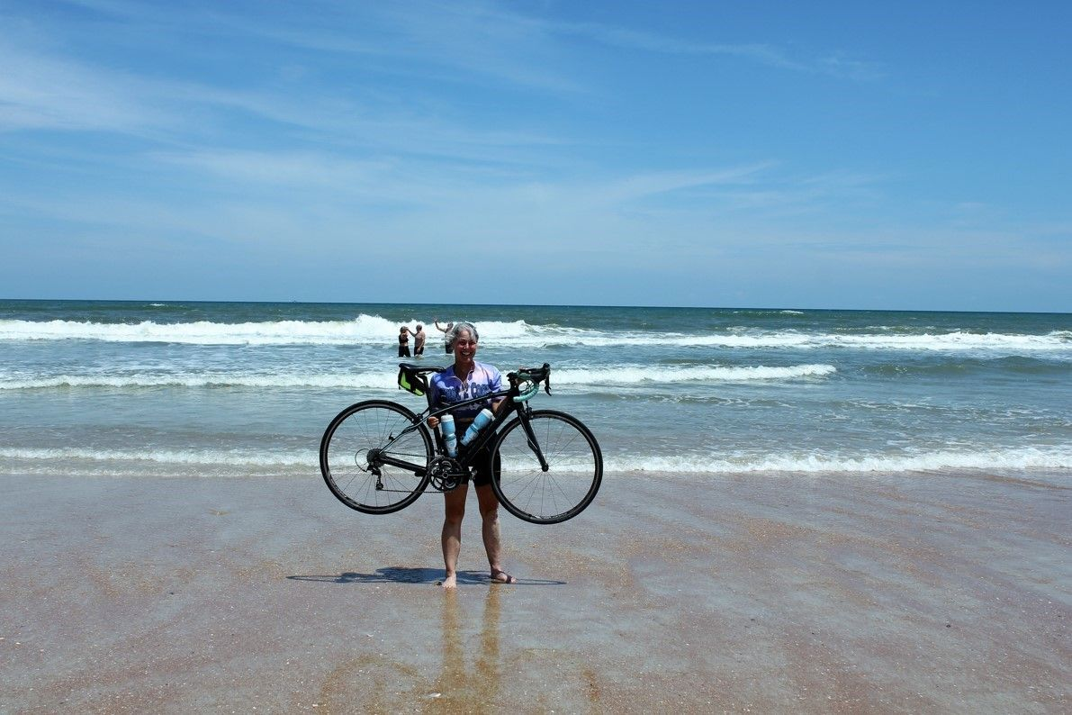 Julie and her bike at the beach