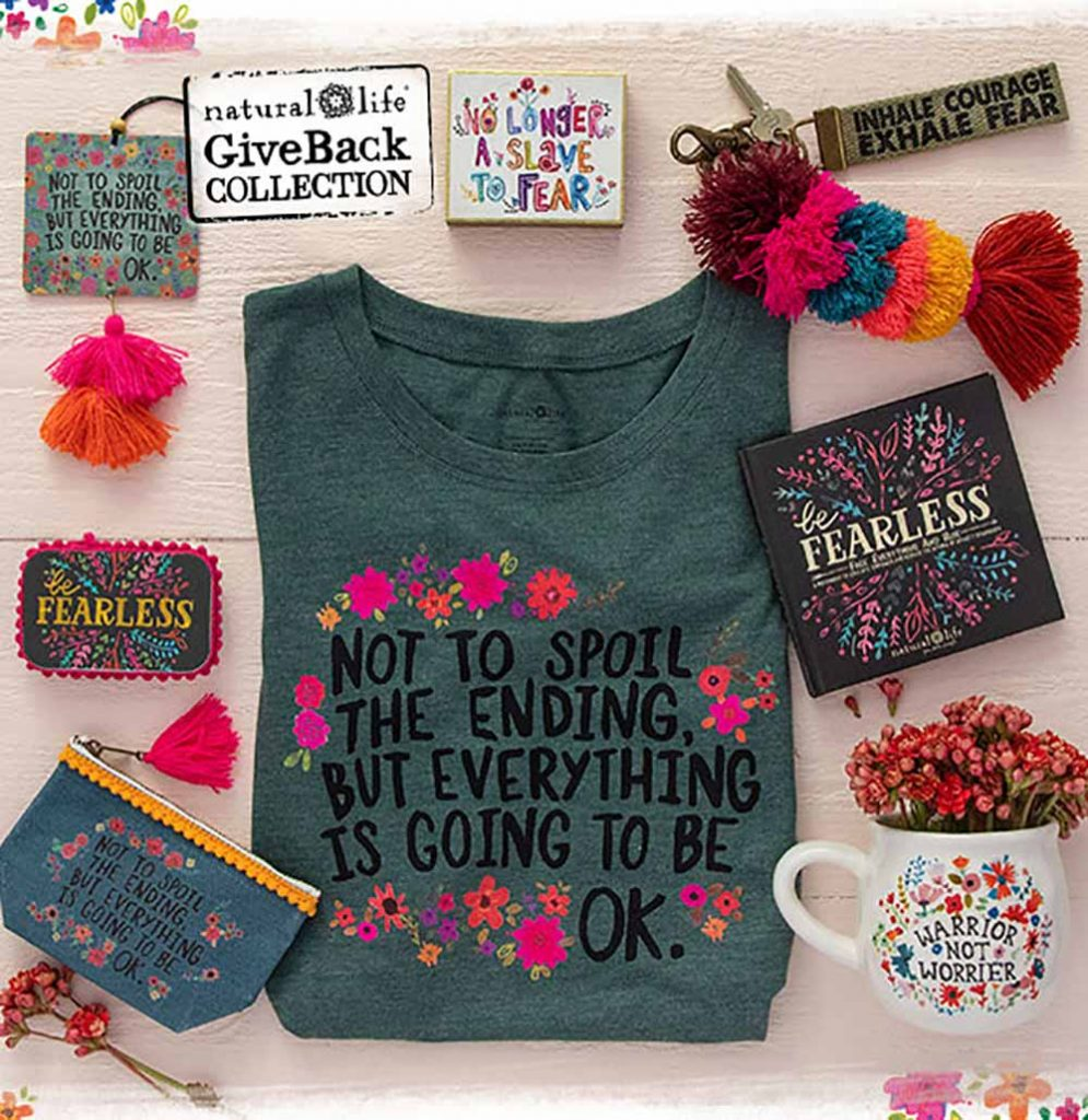 Inspirational Giveback Collection, FEARLESS, featuring flatlay with a tee, mug, book, prayer box and more.