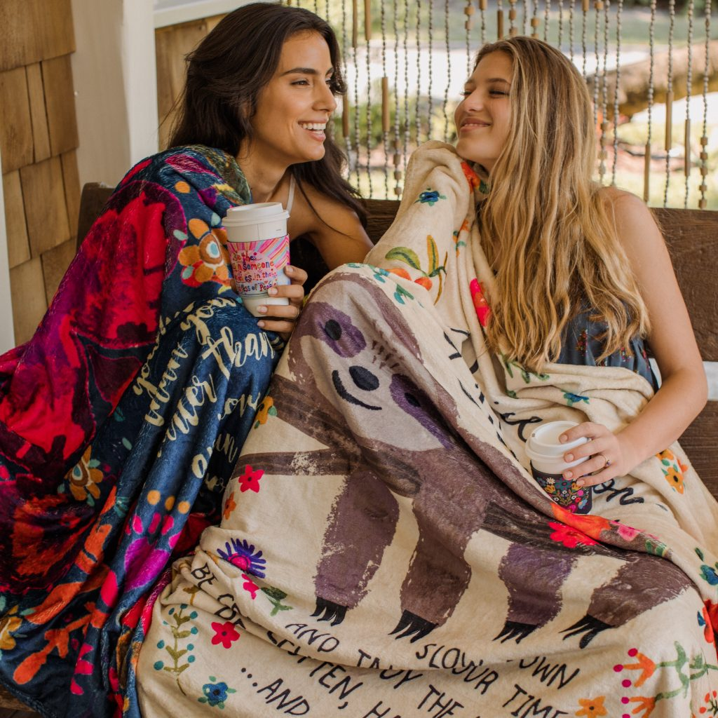 Girls wrapped in tapestry blankets