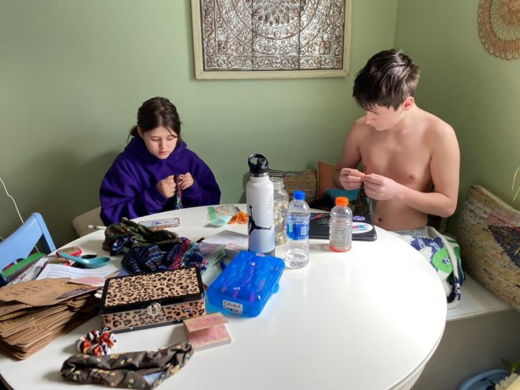 brother and sister making homemade masks