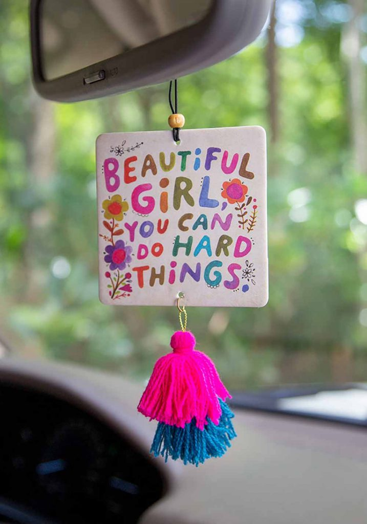 One of Natural Life's Car Accessories, air freshener that says beautiful girl you can do hard things
