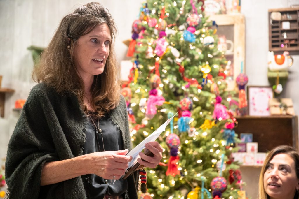Patti giving her speech at the Natural Life Holiday Party