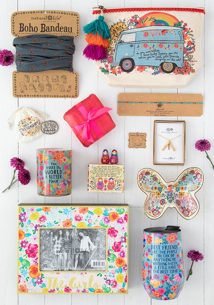 Flatlay of perfect gifts for friends like boho bandeau, canvas pouch, necklaces and more!