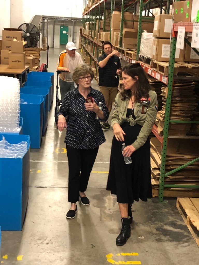 Patti and her mom walking through the warehouse