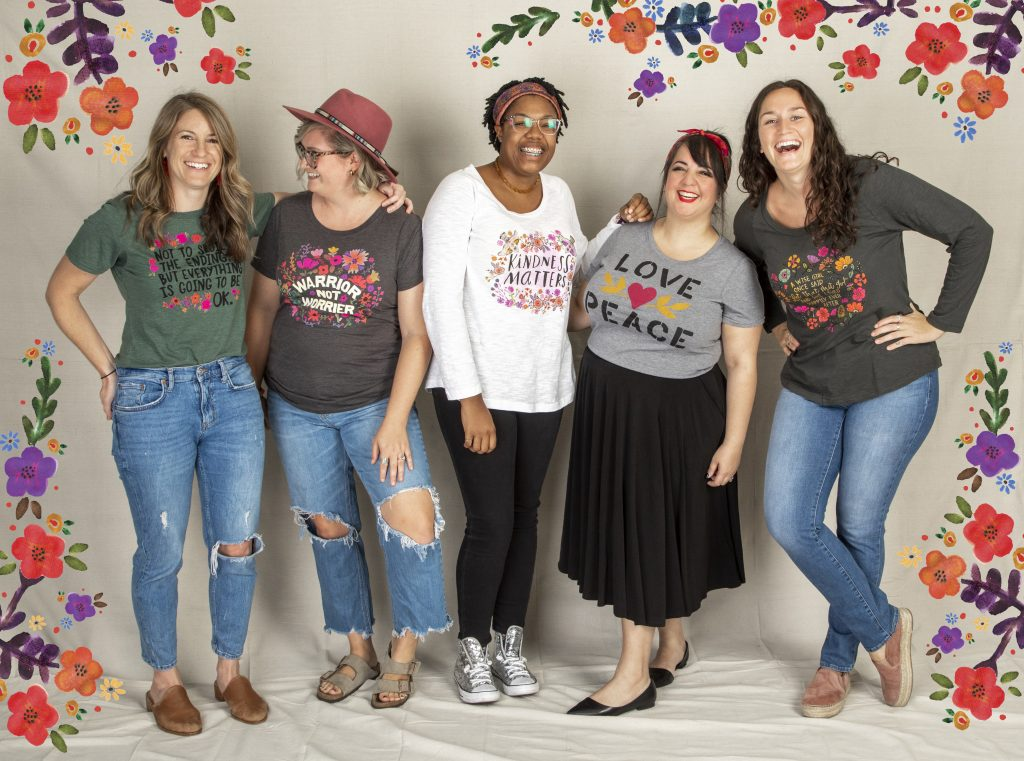 Group of girls laughing wearing Natural Life clothes