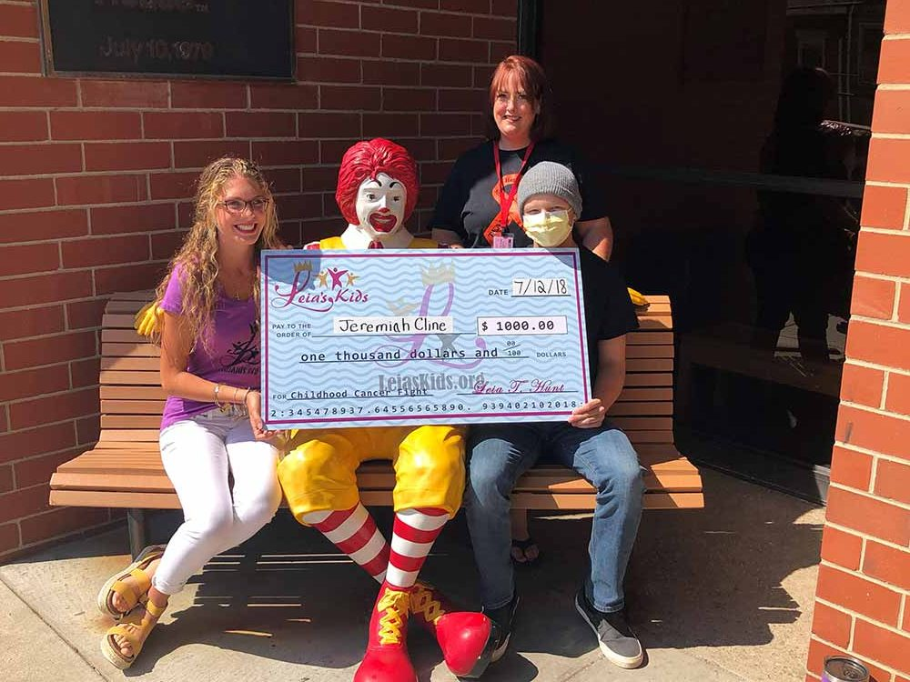 Leia Hunt in front of the Ronald McDonald House. One of Natural Life's favorite non-profits!