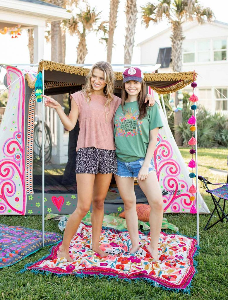 Girls in cute clothes camping in the backyard!
