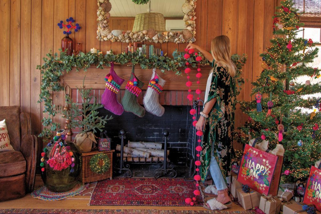 Girl decorating home for Christmas