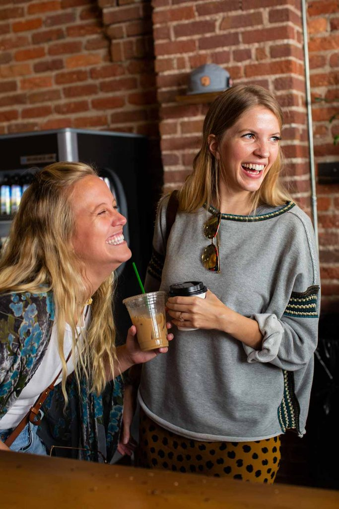 girls laughing with coffee