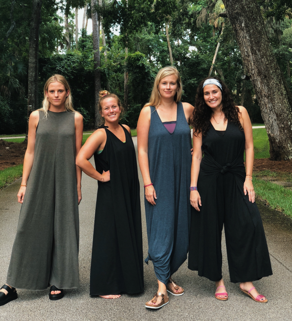 Group of girls wearing Natural Life jumpsuits