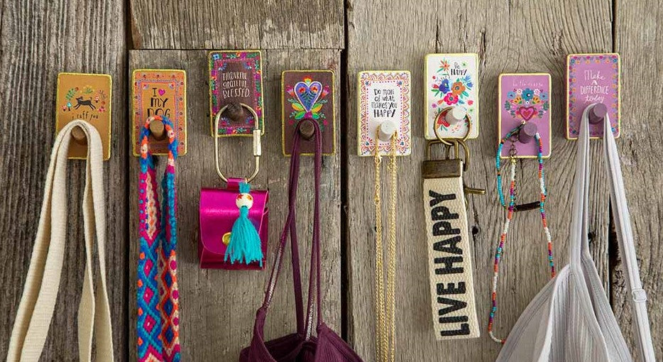 Photo of wooden wall hooks with things hanging from them