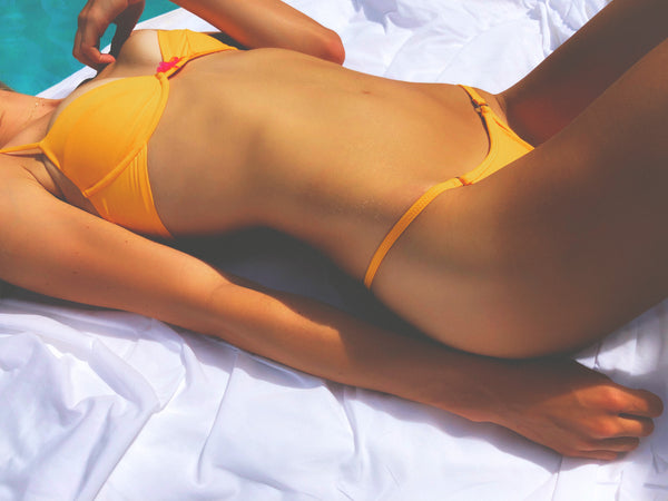 Elles swim orange bikini bottoms paired with Noel underwire push up bra top.