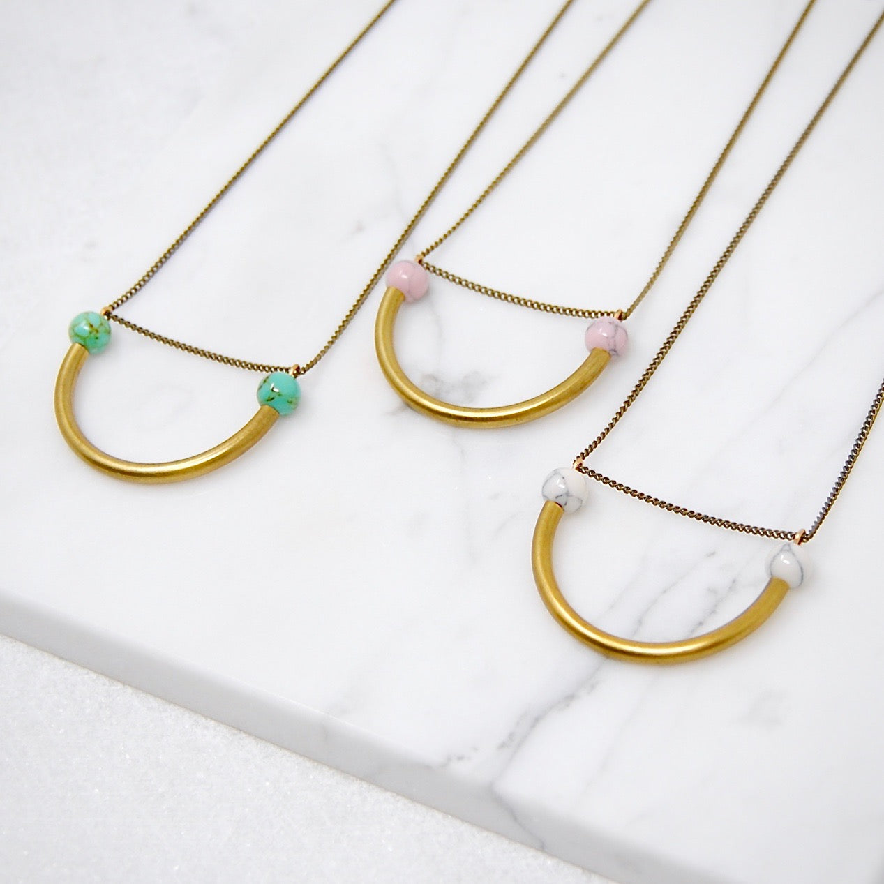 BEADED SEMICIRCLE NECKLACE