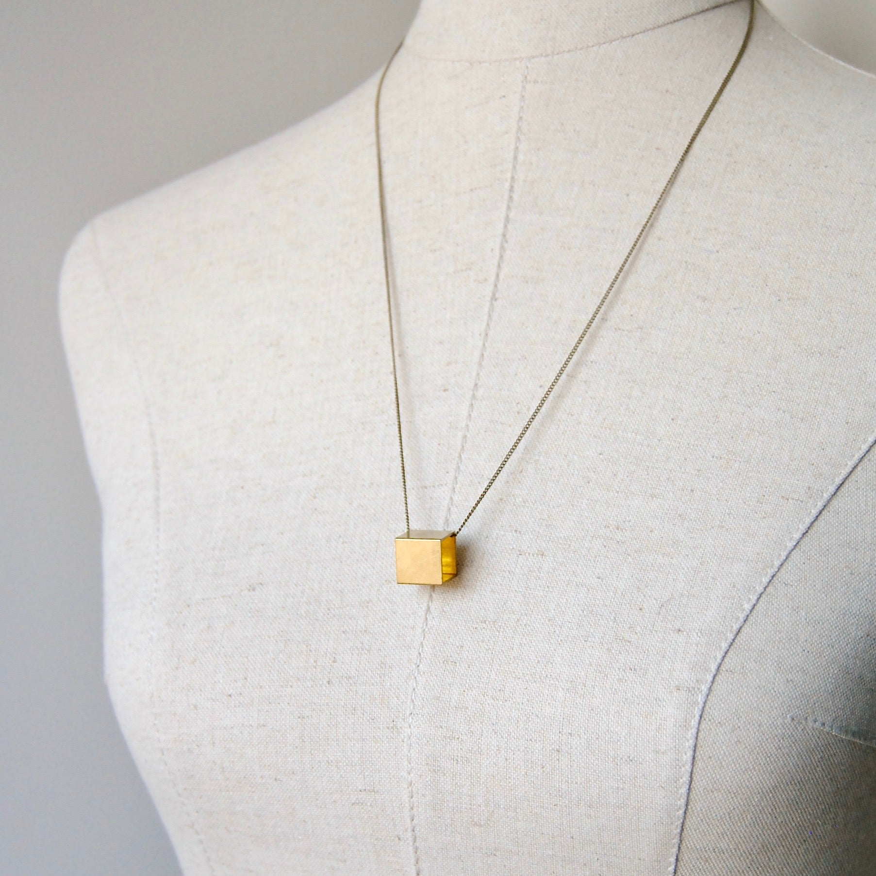 BRASS CUBE NECKLACE