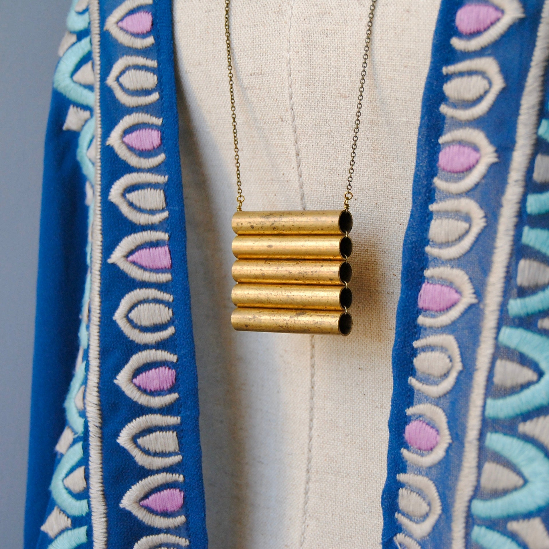 BRASS SHIELD NECKLACE