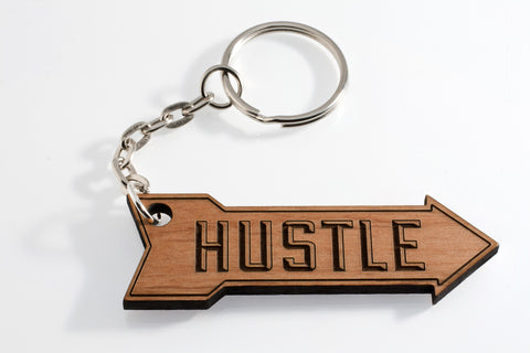 Hustle Keychain handcrafted from alder wood