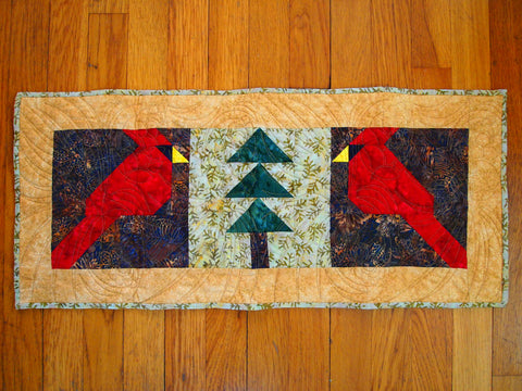 Cardinals & Pines Table Runner with Dark & Light Contrasting Woodsy Batiks Background