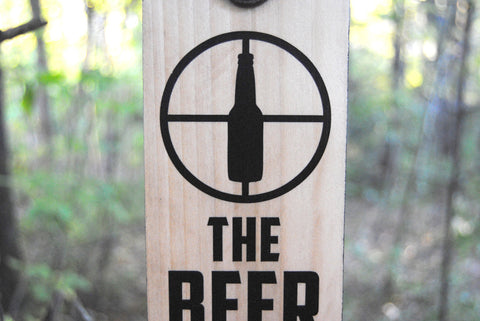 """The Beer Hunter"" wall mounted bottle opener"