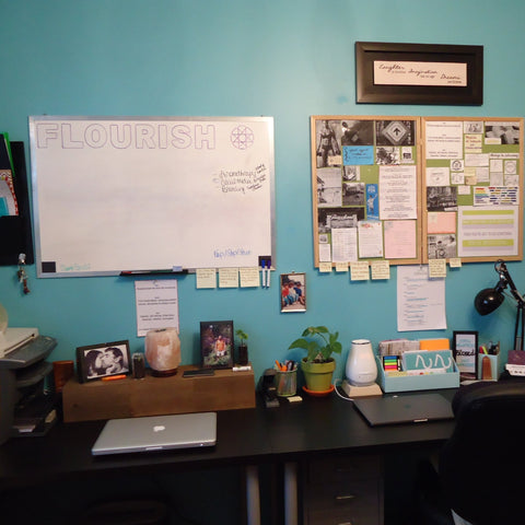 Augmented Gem's Surfer Blue Office, with 'Flourish' Written on a Whiteboard