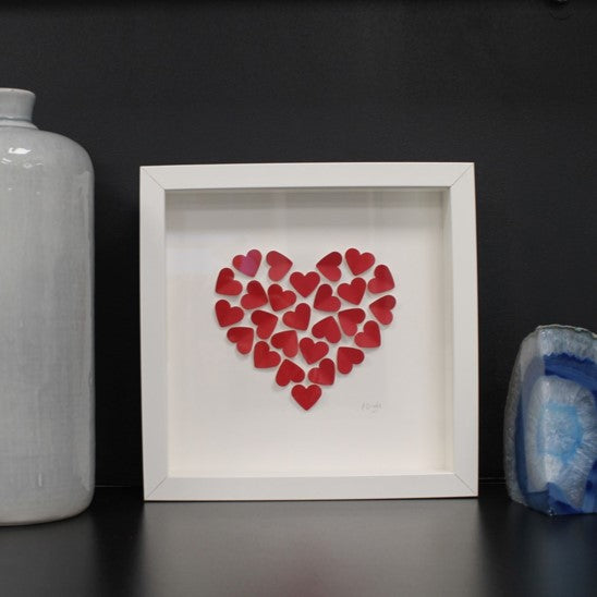 Handmade small white frame medium red hearts in heart shape