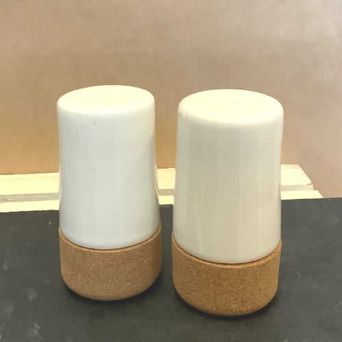 Contemporary salt and pepper shakers make a chic addition to any home!  Made from cork & pottery