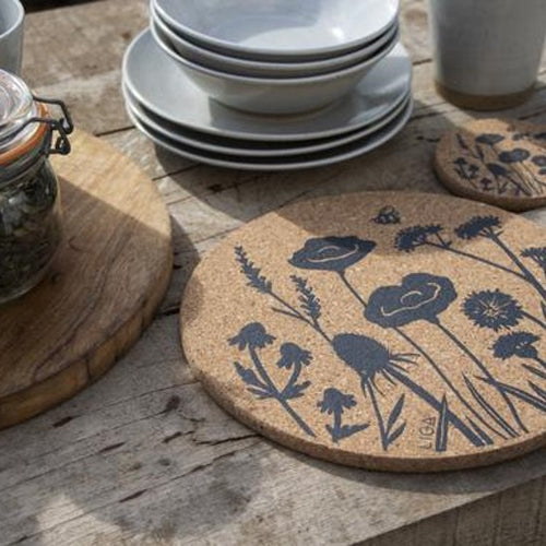 In a wonderful wildflower design, delicate and beautiful for any table.  Cork is sustainable, renewable and recyclable - practical too, water impermeable and easily wipe clean and insulating.