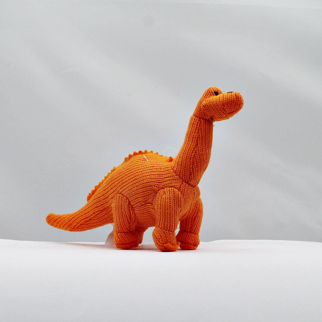 Knitted orange mini Diplodocus rattle