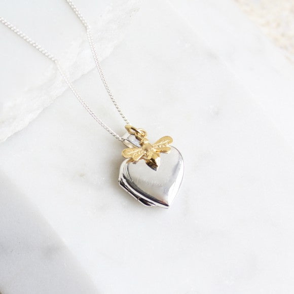 Silver heart locket with gold bee charm