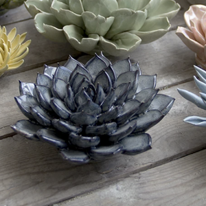 This beautiful ceramic flower is perfect for a decorative wall hanging or table top.