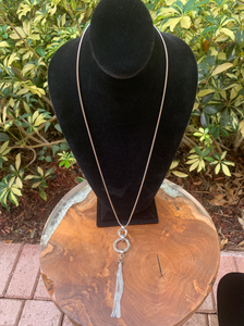 Long Silver Tone Necklace with Circle and Tassel