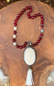 Wine Colored Faceted Bead Necklace with Cameo and Tassle Pendant