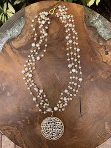 Multi Strand Pearl and Gold Necklace with Cubic and Gold Circle Pendant