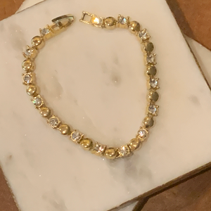 Gold Tone Circle and Crystal Tennis Bracelet