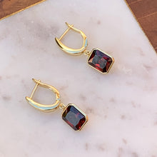 Load image into Gallery viewer, Gold Tone Earrings with Red Emerald Cut Dangle