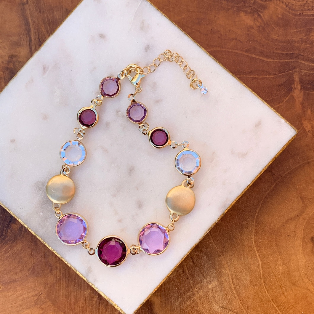 Gold Tone Bracelet with Clear and Purple Tones Crystal Drops